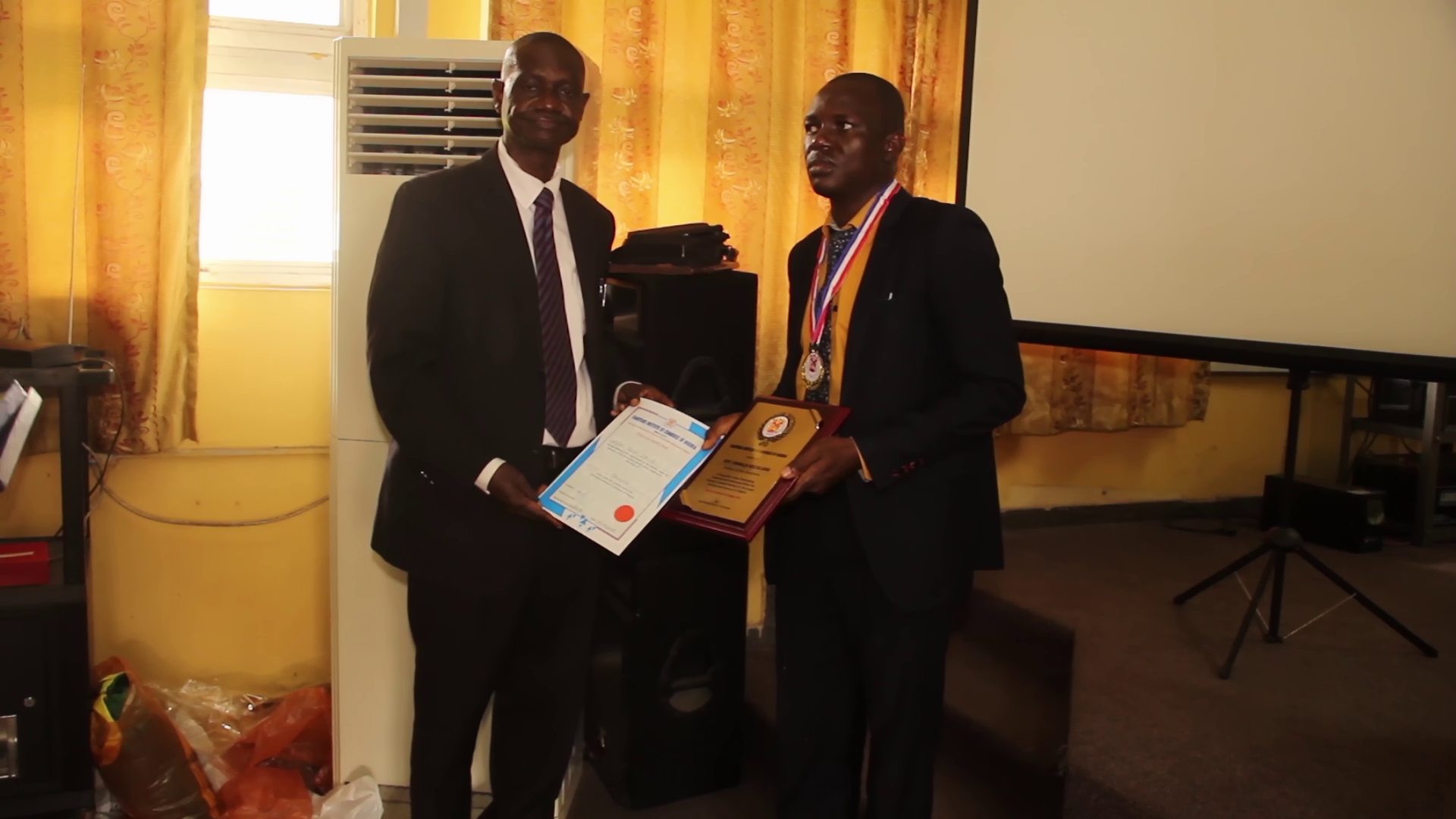Dr Ajayi one of the faculty member of the Institute presented certificate to the newly inductee